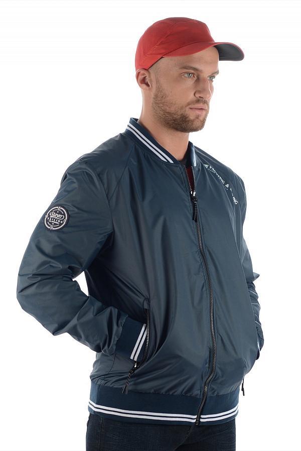 Куртка 17-41607 муж.Куртки<br>Удобная куртка с тематическими декоративными элементами отделки. Модель предназначена для путешествий и для создания стильного повседневного образа.<br><br>технологичный влагозащитный материал<br>отделка подвязом рукавов и низа изделия&lt;/...<br><br>Цвет: Темно-синий<br>Размер: 44
